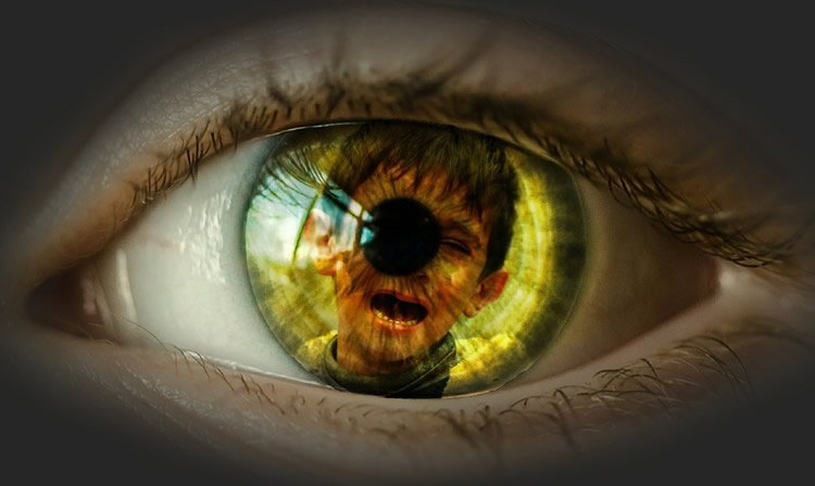 a child's eye with an image of a crying boy inside