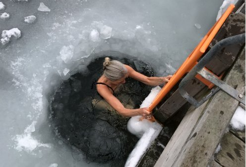 a woman swimming in icy water