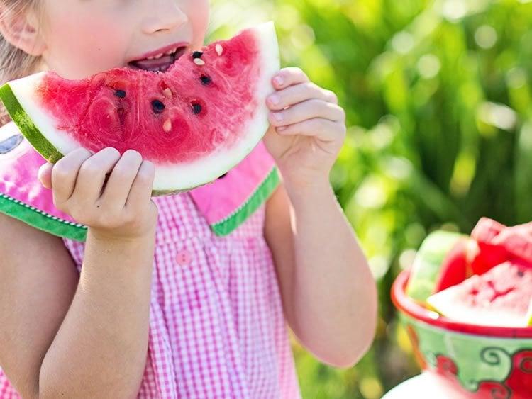 a girl eating fruit