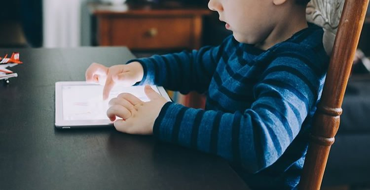 a child with an ipad