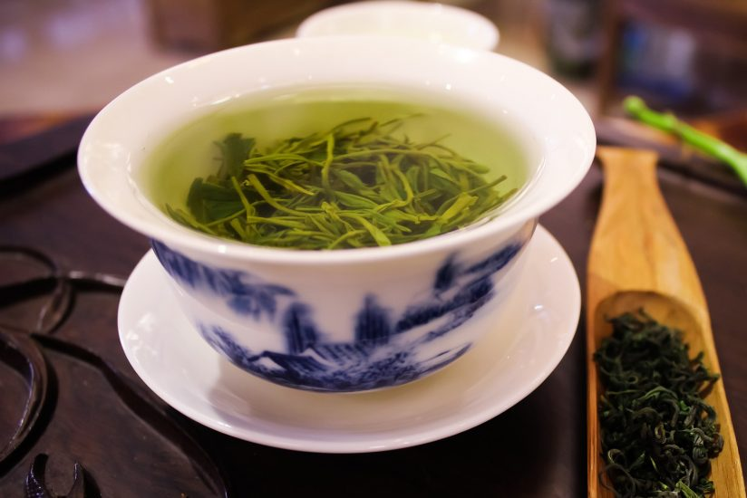 A cup of green tea is shown.