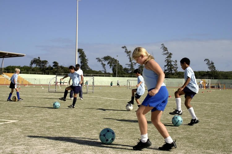 this shows children playing soccer