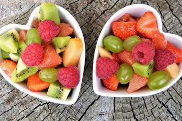 This shows two heart shaped bowls of fruit salad