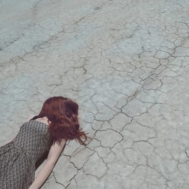This shows a woman laying on the floor