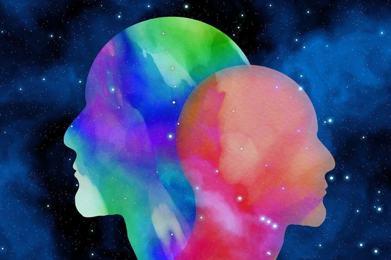 This shows two heads with a psychedelic background