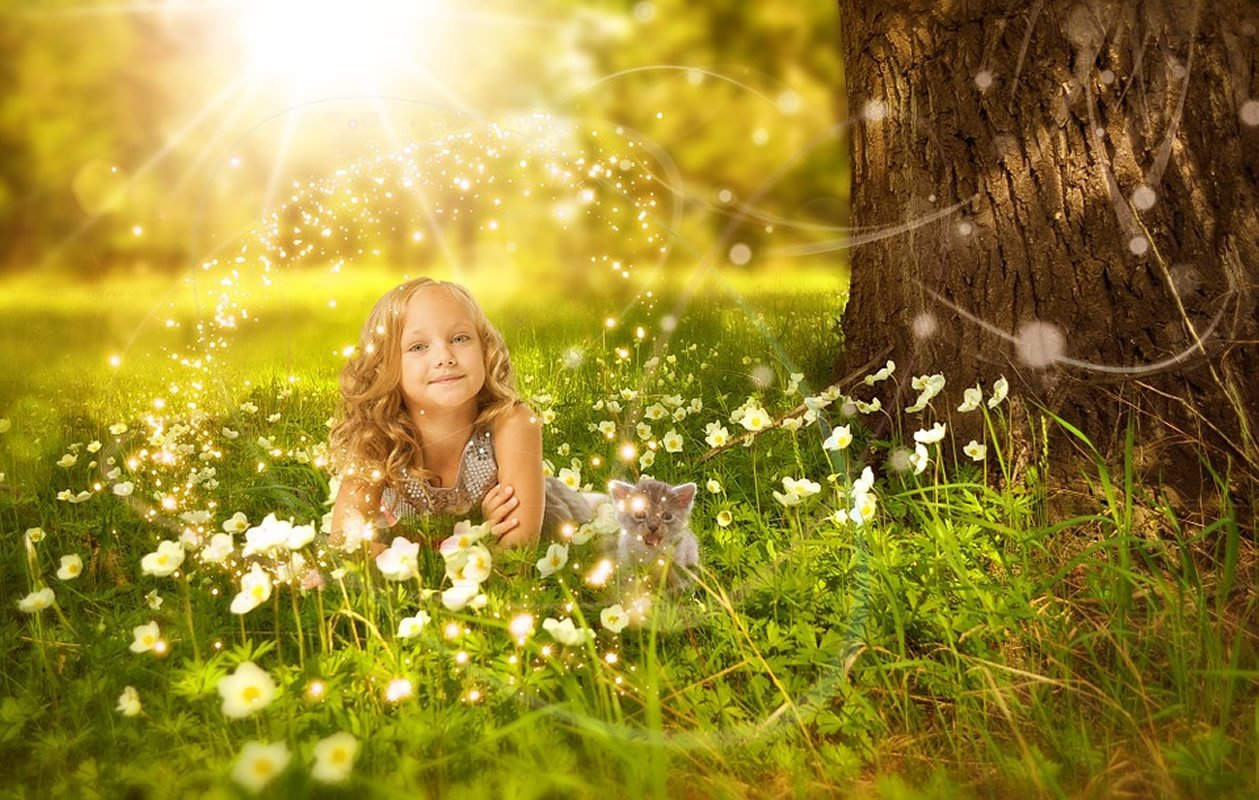 This shows a little girl in the sunshine
