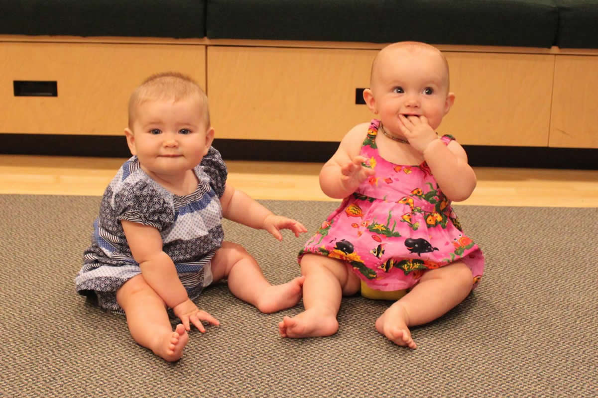 This shows two gorgeous baby girls