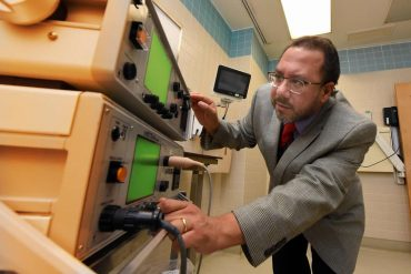 This shows the researcher with the ECT machine