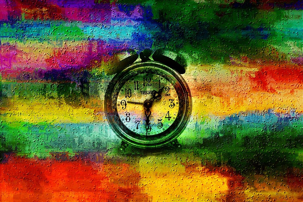 This shows an alarm clock against a multi-colored background
