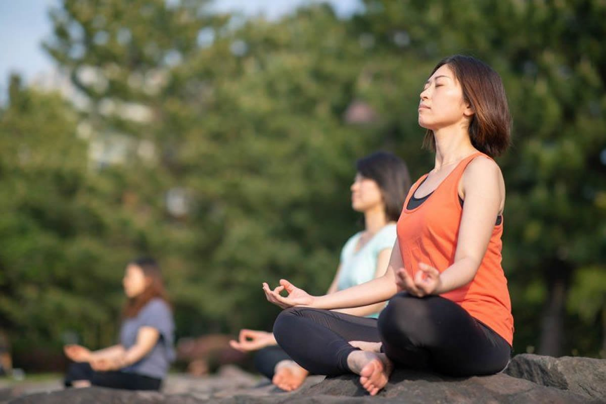 This shows women meditating