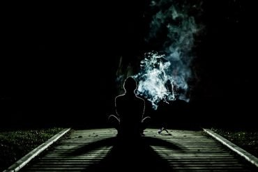 This shows a young person surrounded by smoke