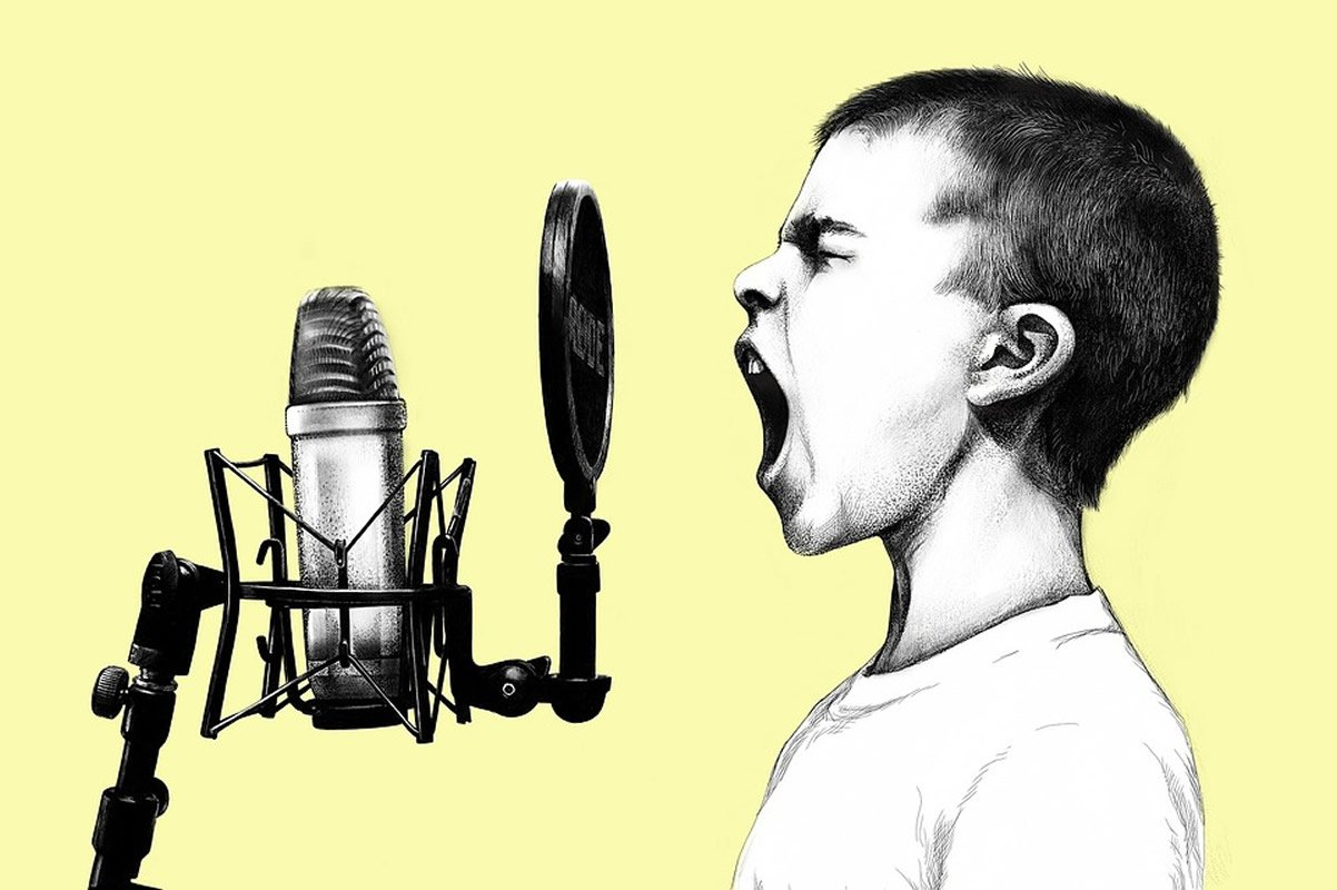 This shows a young boy screaming into a microphone