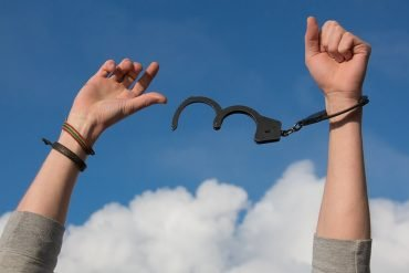 This shows hands breaking free of hand cuffs
