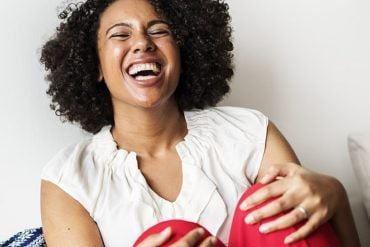 This shows a woman laughing