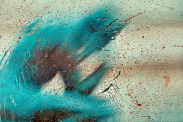 This shows a blurry blue man