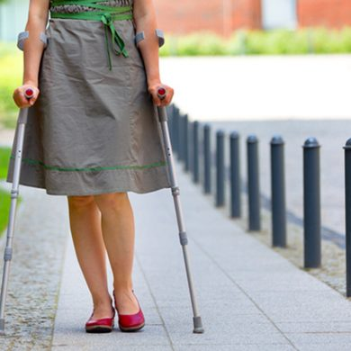 This shows a woman walking with a walking stick