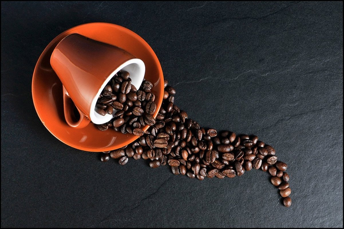 This shows a spilled cup of coffee beans