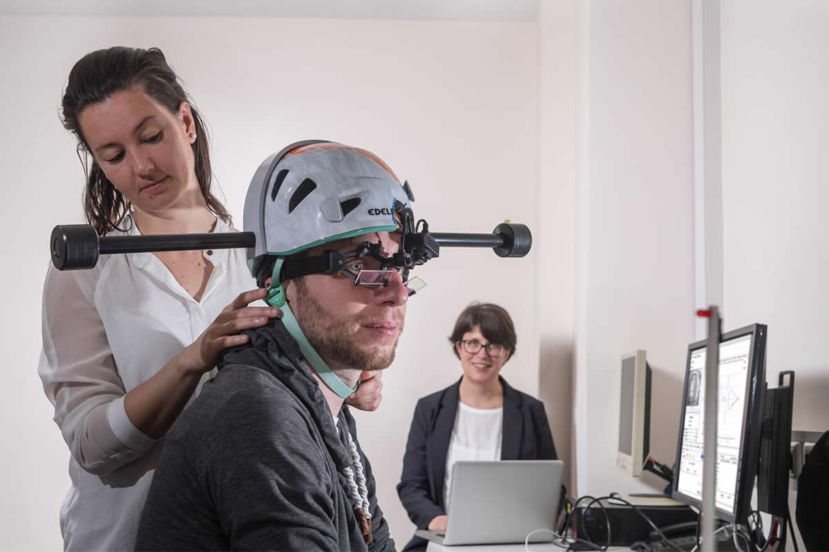 This shows a patient wearing the weighted headset