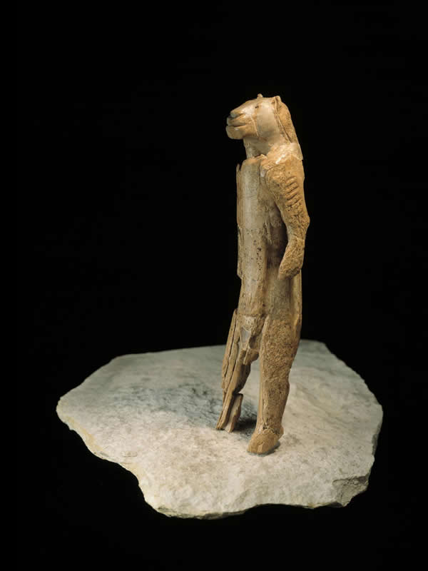 This shows an ancient statue of a lion man