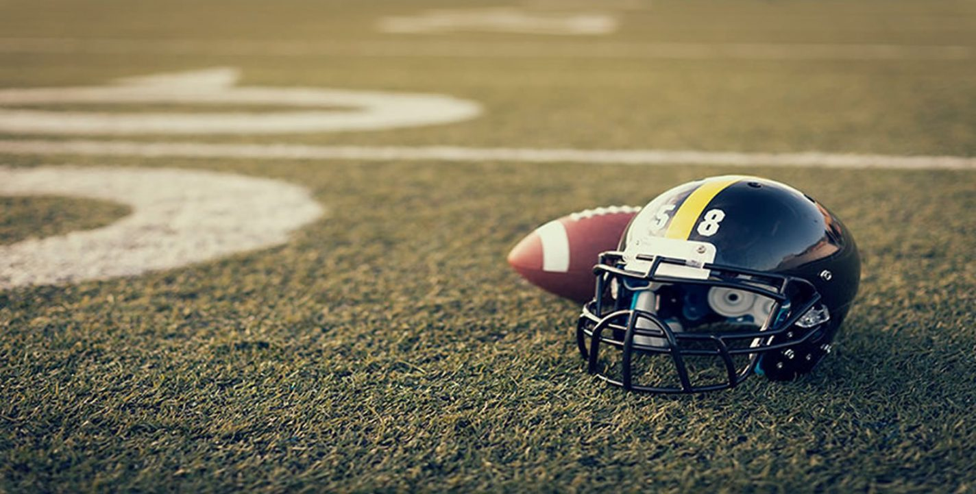 This shows a football and helmet on a field