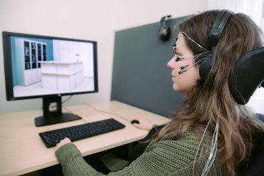 This shows a woman in an EEG cap
