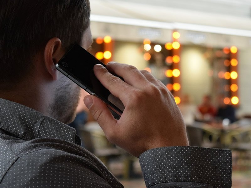 This shows a man talking on a cell phone
