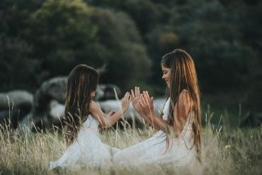 This shows two little girls playing
