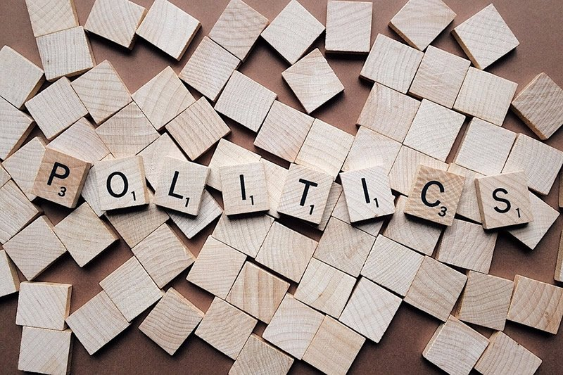 This shows scrabble tiles spelling out politics