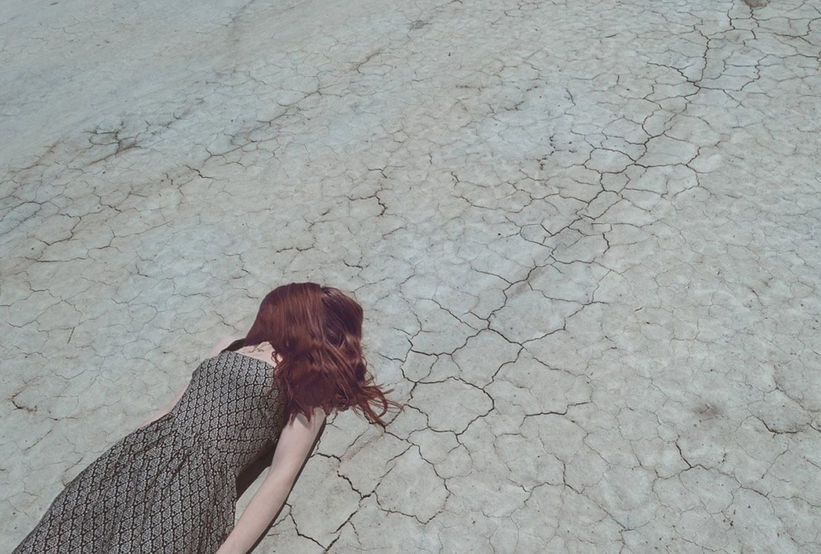 This shows a young woman laying on the floor