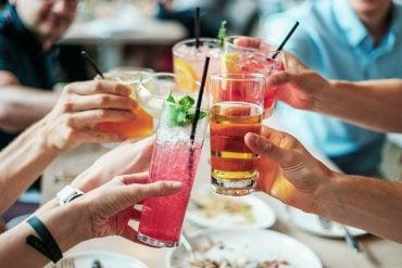 This shows people drinking cocktails