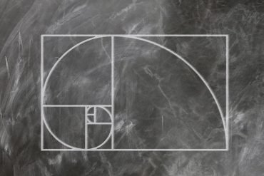 This is a drawing of the golden ratio on a chalk board