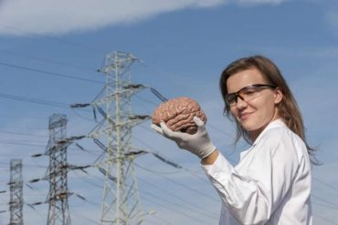 This shows one of the researchers holding a brain model