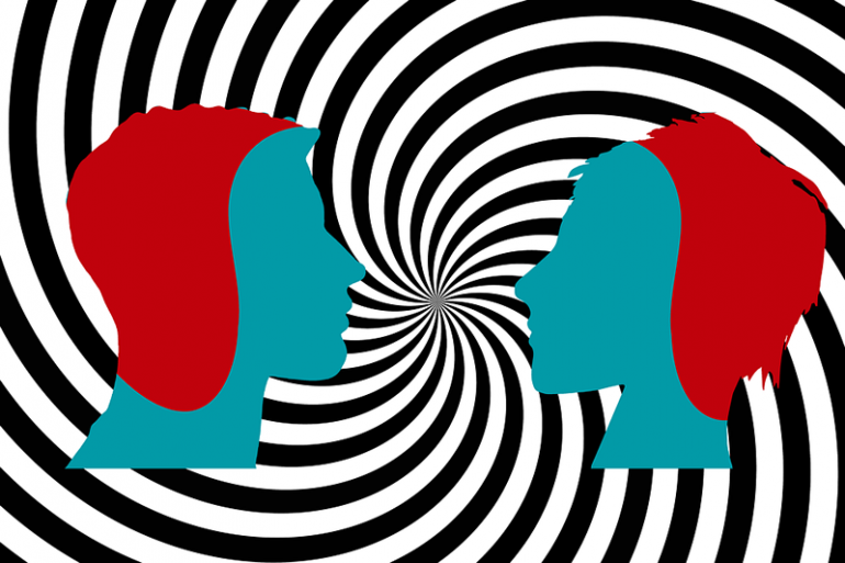 This shows two heads and swirly lines