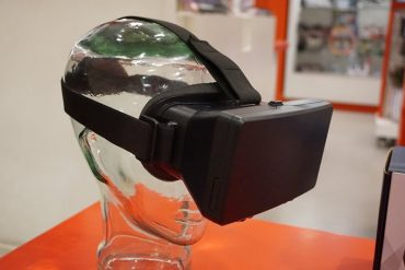 This shows virtual reality glasses on a glass head