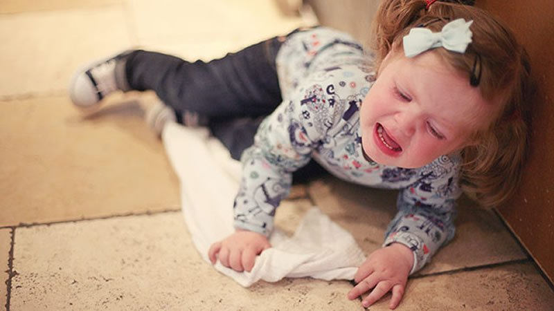 This shows a toddler having a tantrum