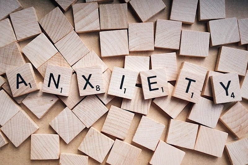This shows scrabble letters spelling out anxiety