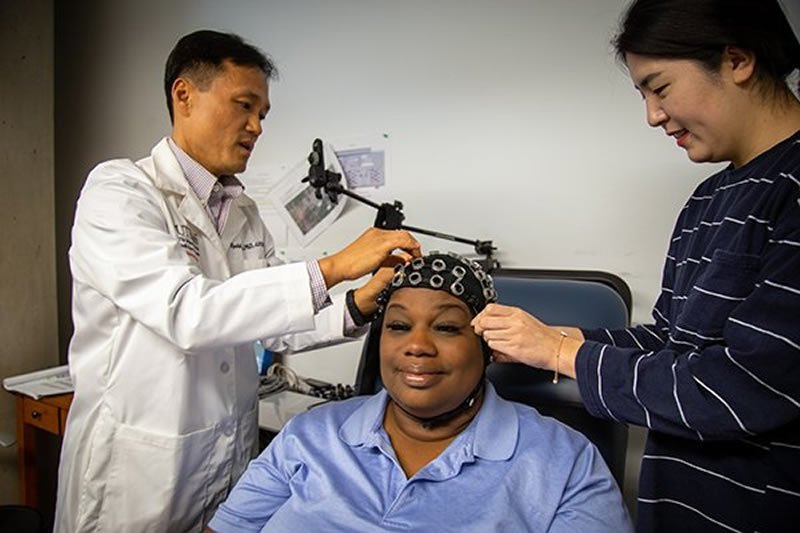 This shows the patient with the tDCS headset