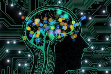 This shows a brain and computer chips