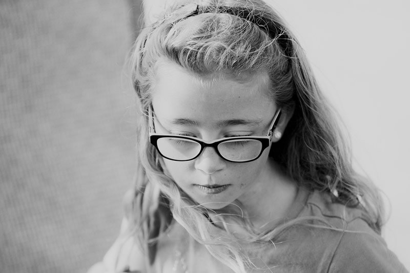 This shows a little girl wearing glasses