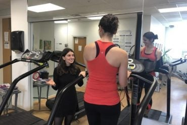 This shows a woman using exercise equipment