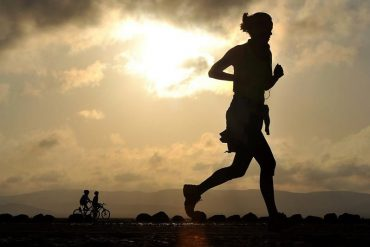 This shows a woman running
