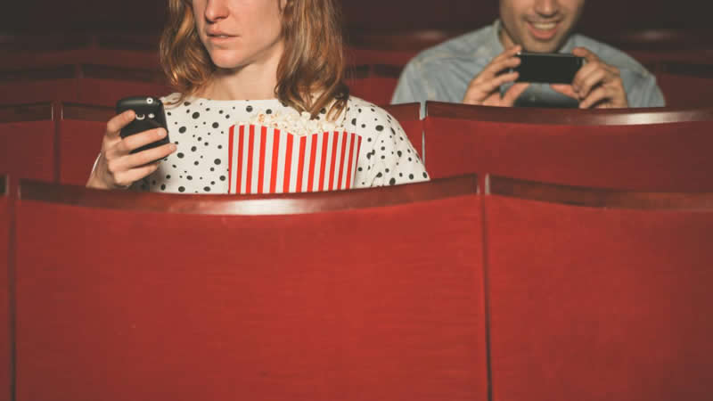 This shows people in a movie theatre