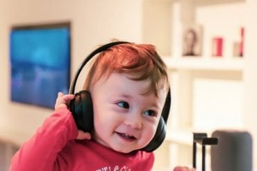 This shows a toddler in headphones