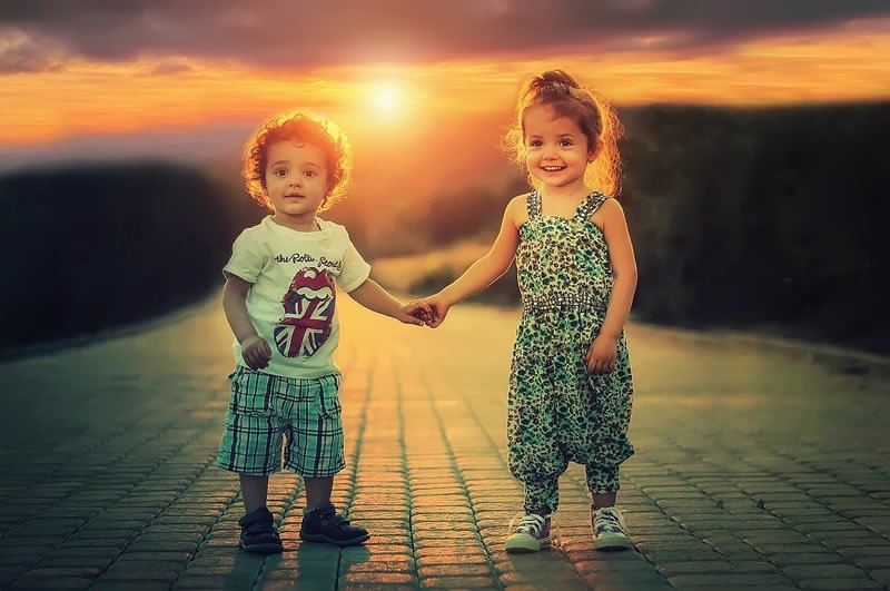 This shows a little boy and girl