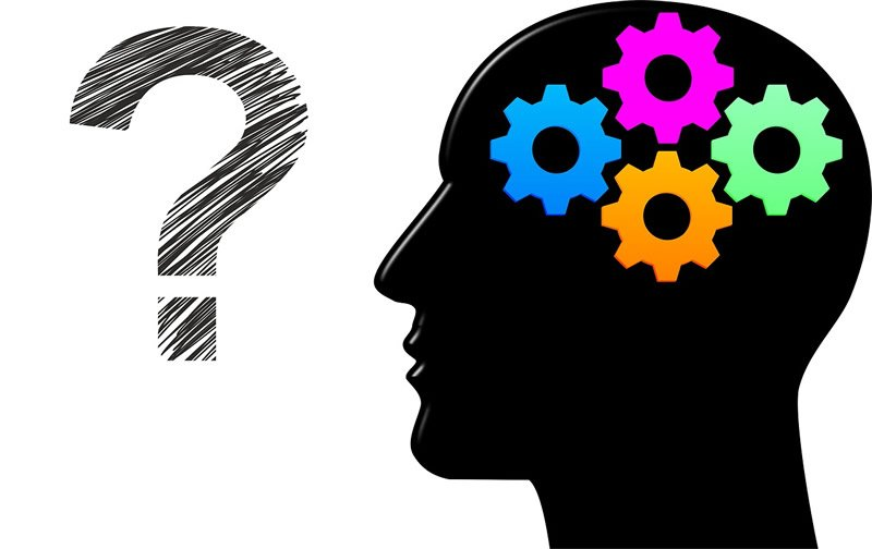 A brain and questionmark are shown
