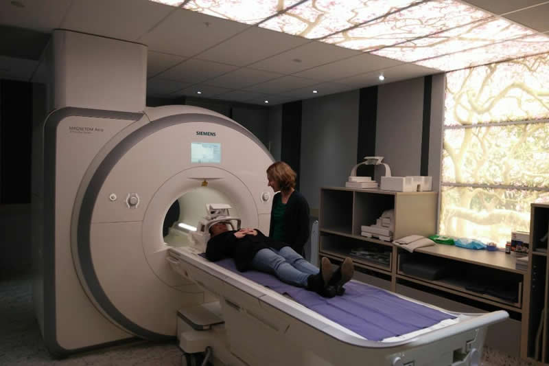 This shows the researcher and an fMRI scanner