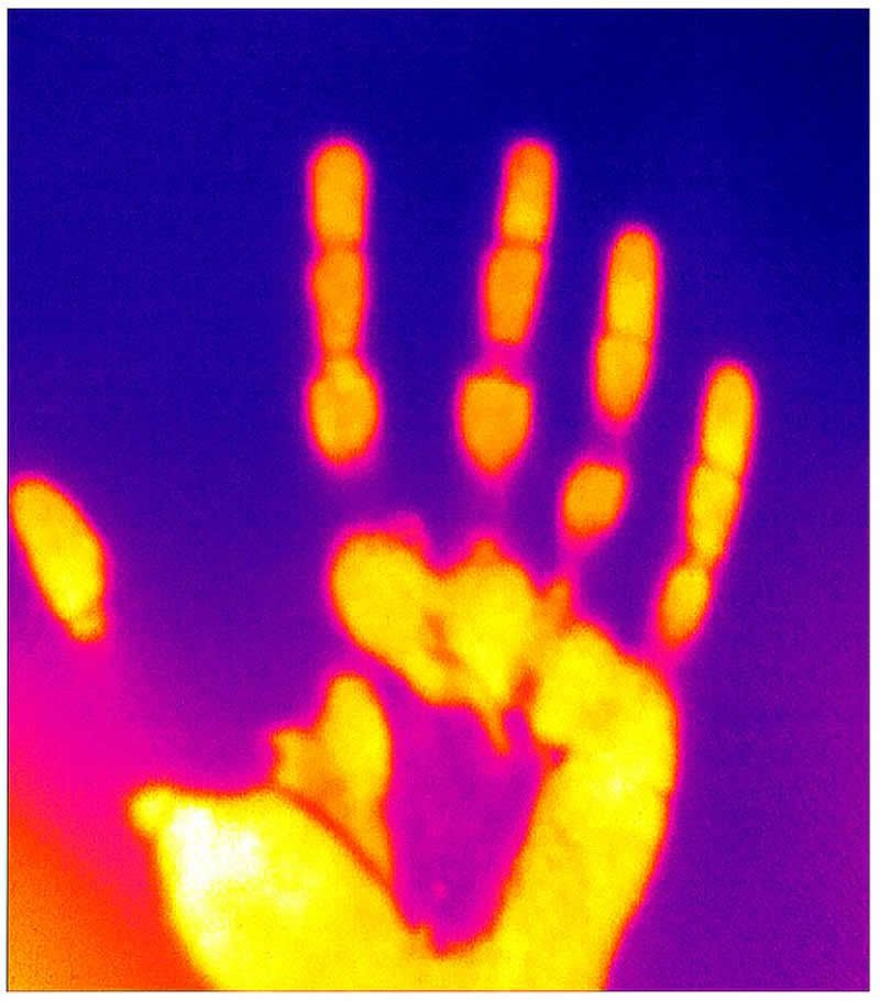 This shows a handprint in thermal light