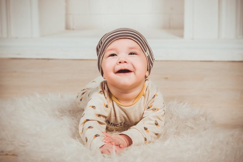 This shows a happy baby