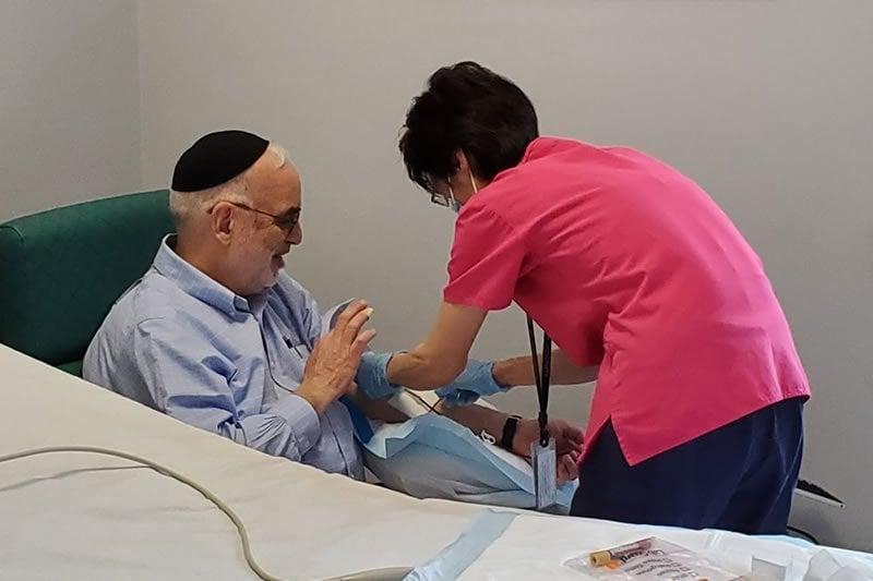 This shows a man donating plasma