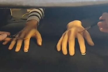 This shows the rubber hand illusion experiment being performed